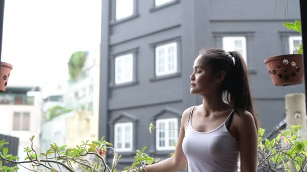 Beautiful Asian Woman Thinking Outdoors In Balcony