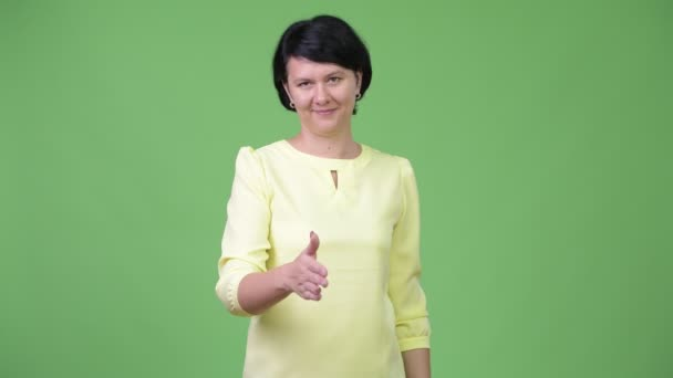 Beautiful businesswoman with short hair giving handshake
