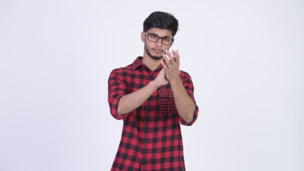 Young happy bearded Indian hipster man clapping hands