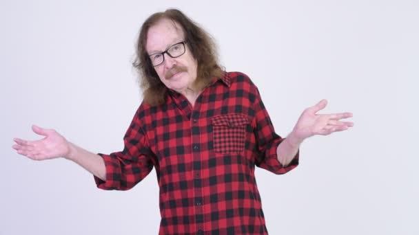 Senior hipster man shrugging shoulders