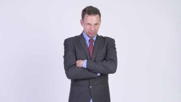 Studio shot of angry businessman with arms crossed