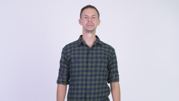 Studio shot of happy hipster man smiling while thinking