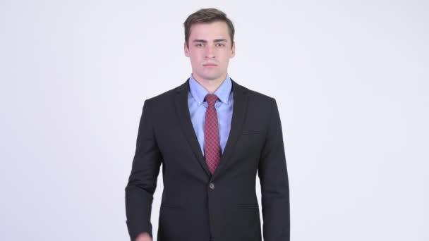 Young handsome businessman giving handshake