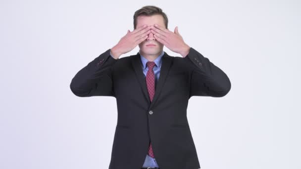Young handsome businessman showing three wise monkeys concept
