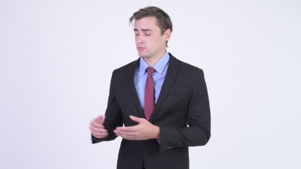 Young handsome businessman presenting something