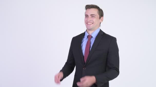Mladý šťastný pohledný podnikatel tleskali