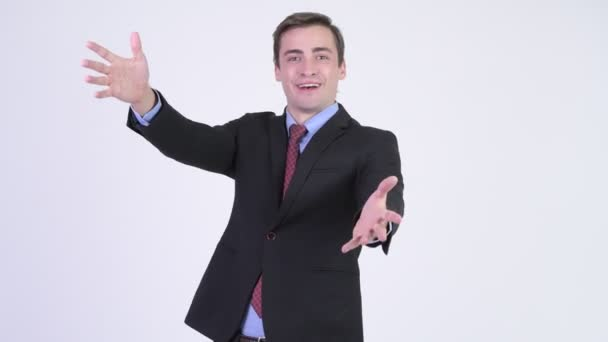 Young happy handsome businessman with surprise gesture