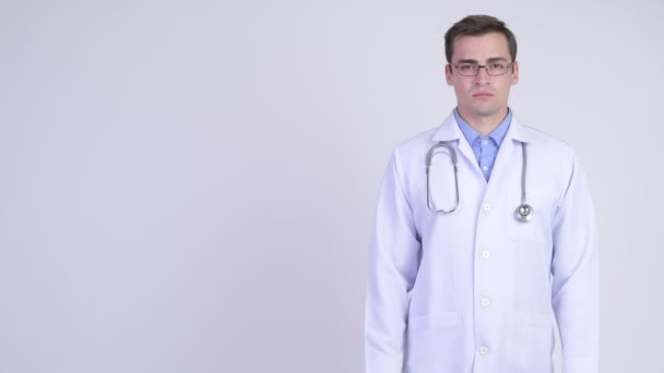 Young happy handsome man doctor showing something