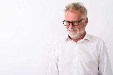 Studio shot of sad senior bearded man thinking while looking dow