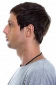 Fotografia Vista di profilo del volto di giovane uomo bello