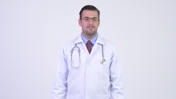 Mladá zdůraznil hispánské člověčí doktor dává palec dolů