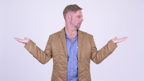 Blonde casual businessman comparing something
