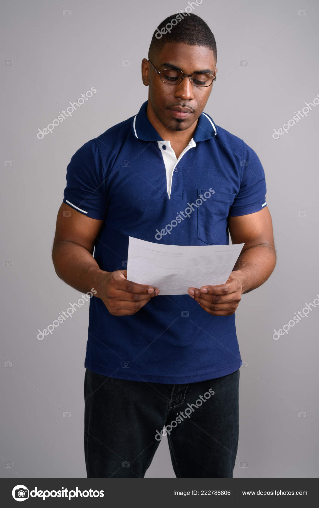 443ddc1b4 Young handsome African man wearing blue polo shirt against gray — Stock  Photo