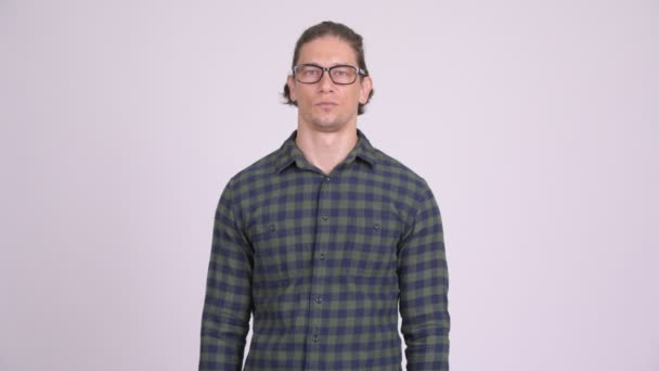Happy hipster man smiling with arms crossed