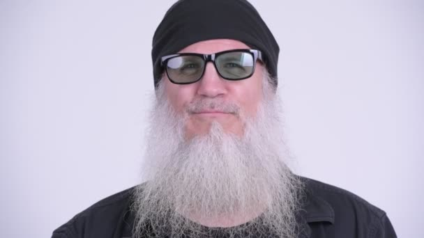 Face of happy mature bearded hipster man with sunglasses smiling
