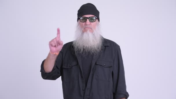 Mature bearded hipster man pointing up