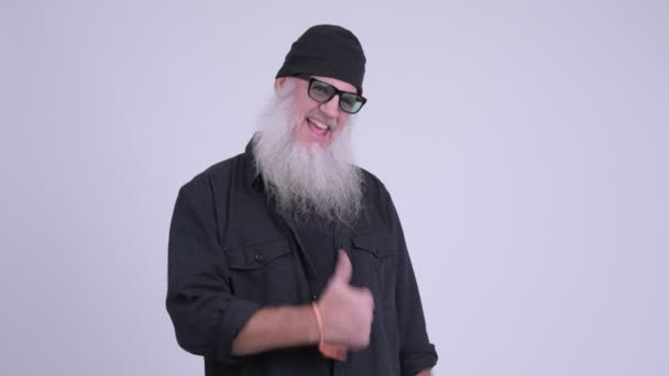 Happy mature bearded hipster man smiling and giving thumbs up