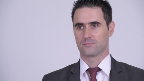Tvář pohledný podnikatel myšlení proti Bílému pozadí