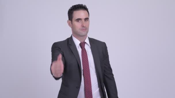 Handsome businessman giving handshake