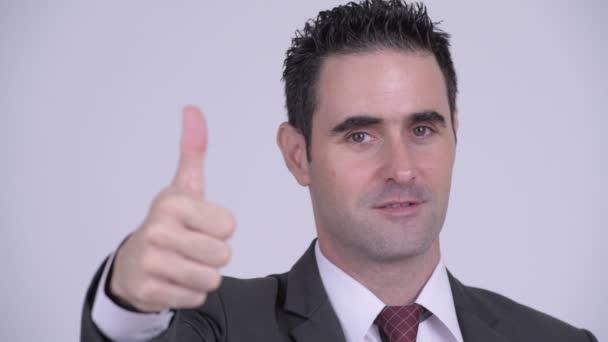 Tvář šťastný pohledný podnikatel dává palec