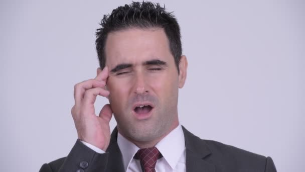 Face of stressed businessman having headache
