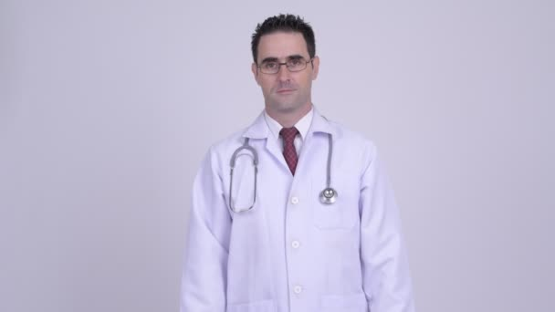 Happy handsome man doctor wearing eyeglasses with arms crossed