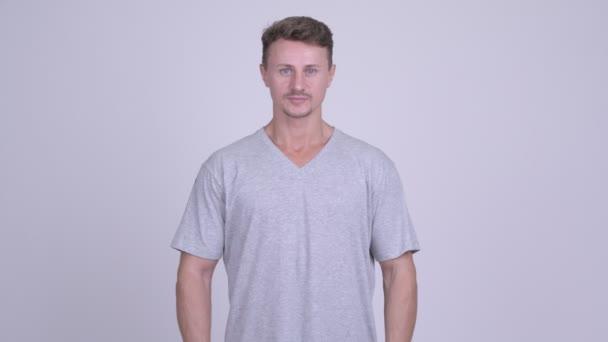 Studio shot of handsome bearded man against white background