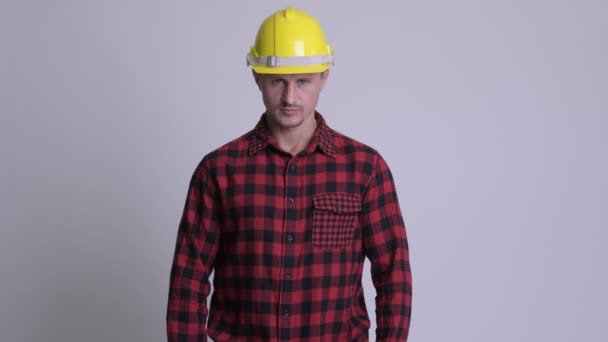Happy bearded man construction worker smiling with arms crossed