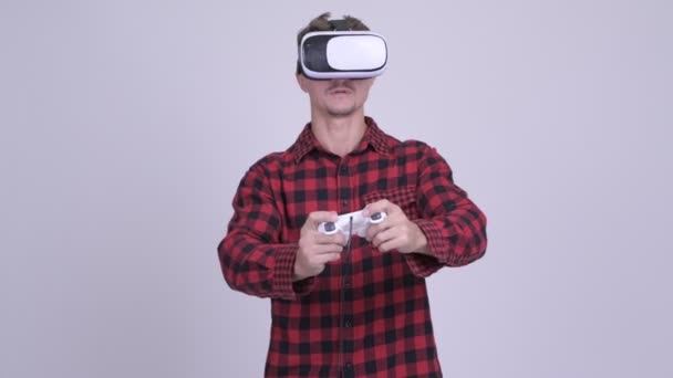 Hipster man playing games with virtual reality headset
