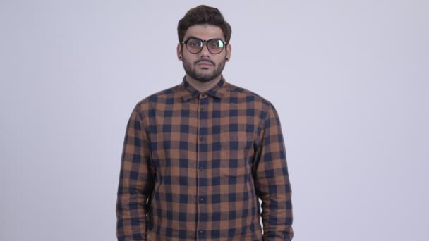Happy young bearded Indian hipster man smiling