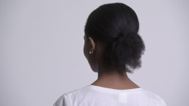Closeup rear view of happy young beautiful African woman smiling and looking back
