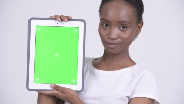 Face of happy young beautiful African woman showing digital tablet