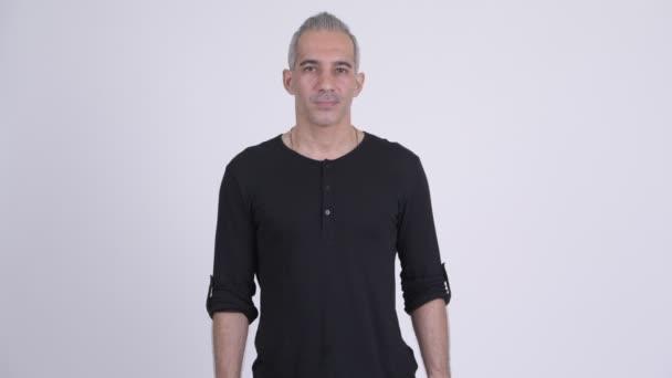 Studio shot of handsome Persian man against white background