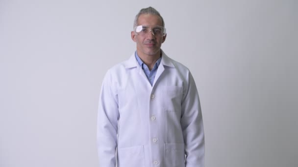 Happy Persian man doctor wearing protective glasses
