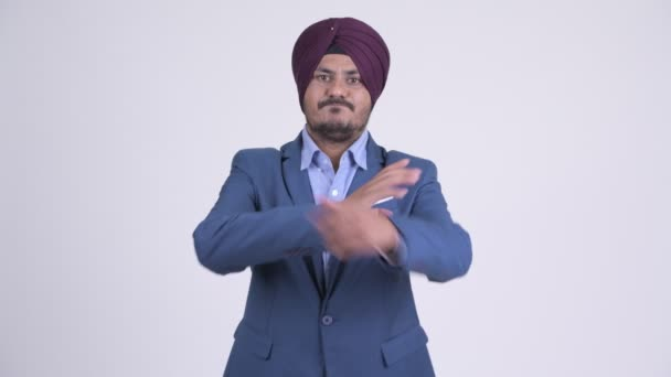 Angry bearded Indian Sikh businessman with arms crossed