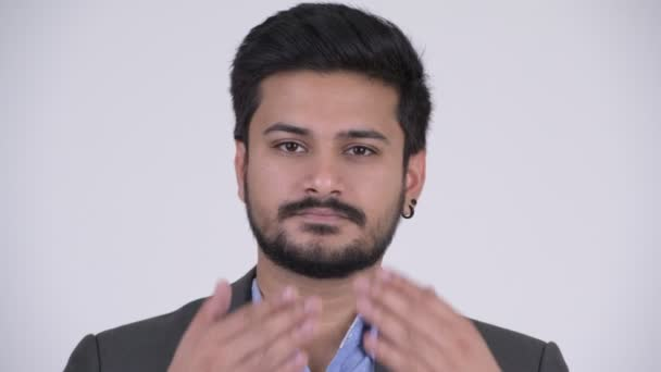 Young handsome bearded Indian businessman covering eyes as three wise monkeys concept