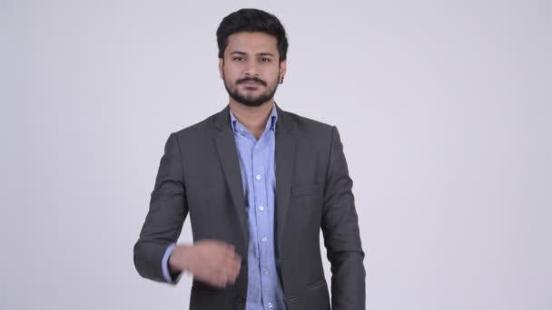 Mladí rádi vousatých indický podnikatel dává handshake