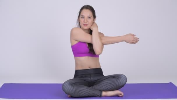 Young beautiful multi-ethnic woman doing yoga pose