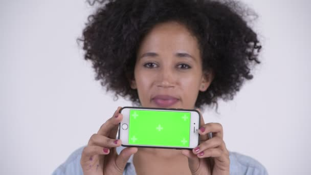 Face of young happy African woman showing phone