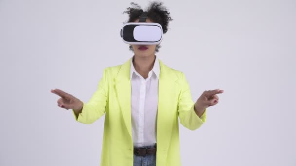 Young beautiful African businesswoman using virtual reality headset