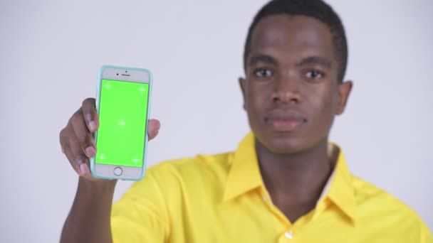 Face of young happy African businessman showing phone