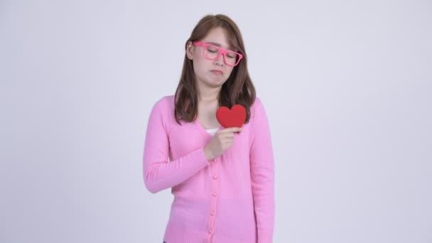 Mladí smutná Asijská nerd žena stále ještě překvapit pro valentinky den