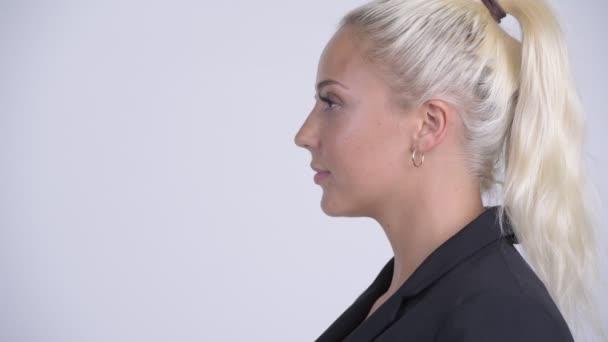 Closeup profile view of young beautiful blonde businesswoman