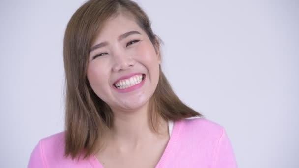Tváře mladých šťastný asijské ženy s úsměvem