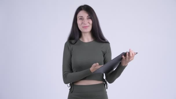 Young beautiful woman holding clipboard