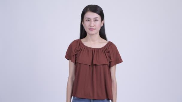 Happy beautiful Asian woman smiling