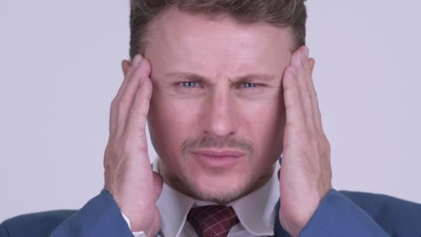 Face of stressed bearded businessman having headache