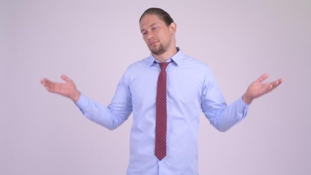 Stressed businessman doing various gestures while looking depressed