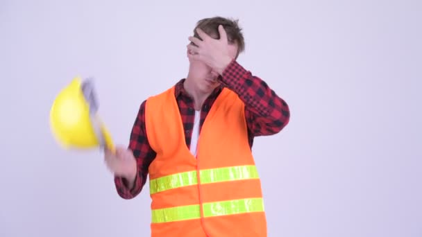 Strssed young man construction worker looking tired