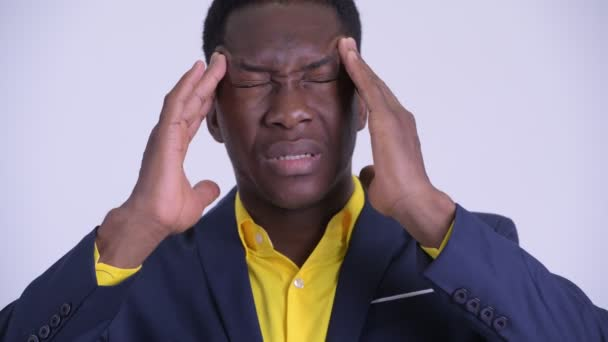 Face of young stressed African businessman having headache